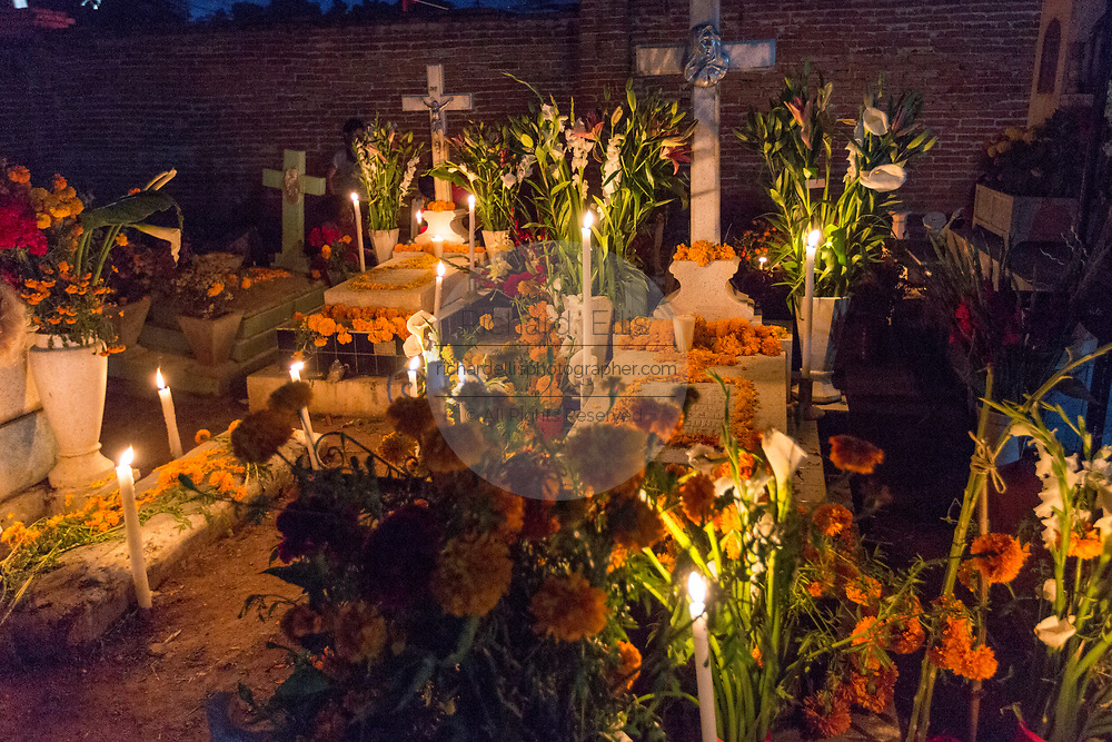 The old cemetery decorated for Day of the Dead festival known in Spanish as Día de Muertos at October 31, 2013 in Xoxocotlan, Mexico. The festival celebrates the lives of those that died.
