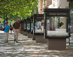 Luxury products in glass display cabinets at Louis Vuitton boutique on Kurfurstendamm Charlottenburg Berlin Germany