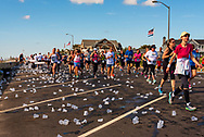 Spring Lake, NJ, USA -- May 27, 2017. Discarded water cups are all over the street in the wake of the runners.