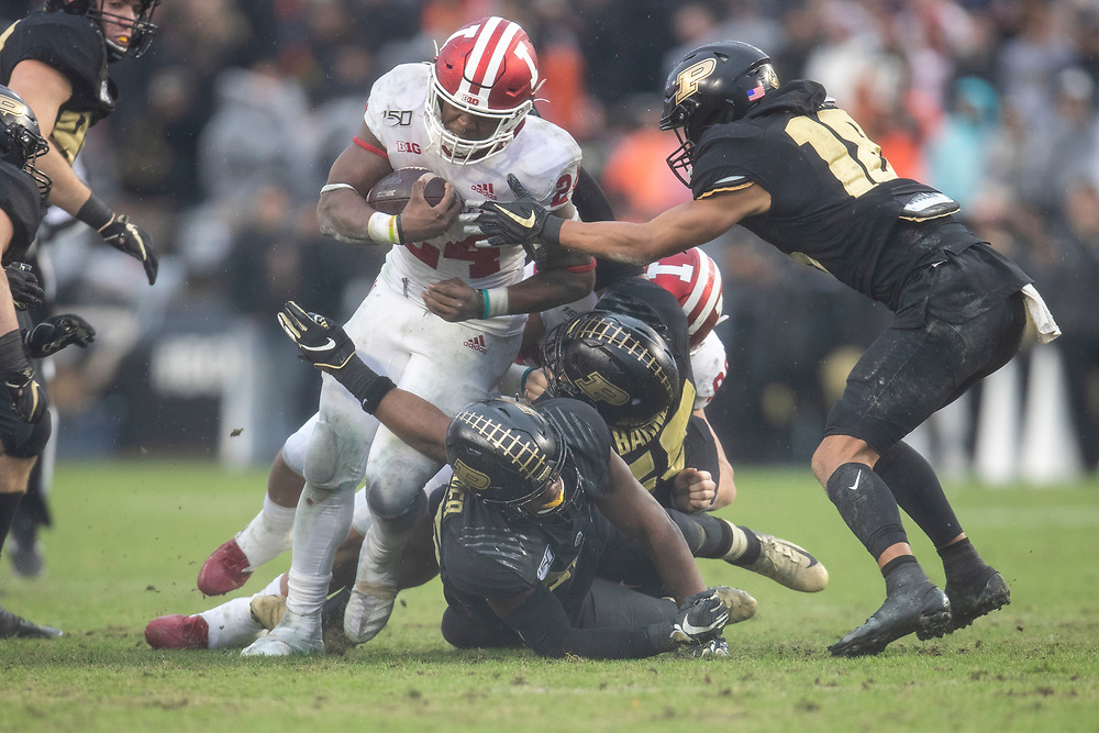 November 30, 2019:  Indiana running back James Sampson (24) runs with the ball as Purdue defenders attempt to make the tackle during NCAA football game action between the Indiana Hoosiers and the Purdue Boilermakers at Ross-Ade Stadium in West Lafayette, Indiana.  Indiana defeated Purdue 44-41 in double overtime.  John Mersits/CSM.