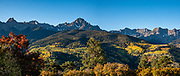 Mt Sneffels rises above yellow fall aspen colors along Ouray County Road 5, in Uncompahgre National Forest, Ridgway, Colorado, USA. This image was stitched from multiple overlapping photos.