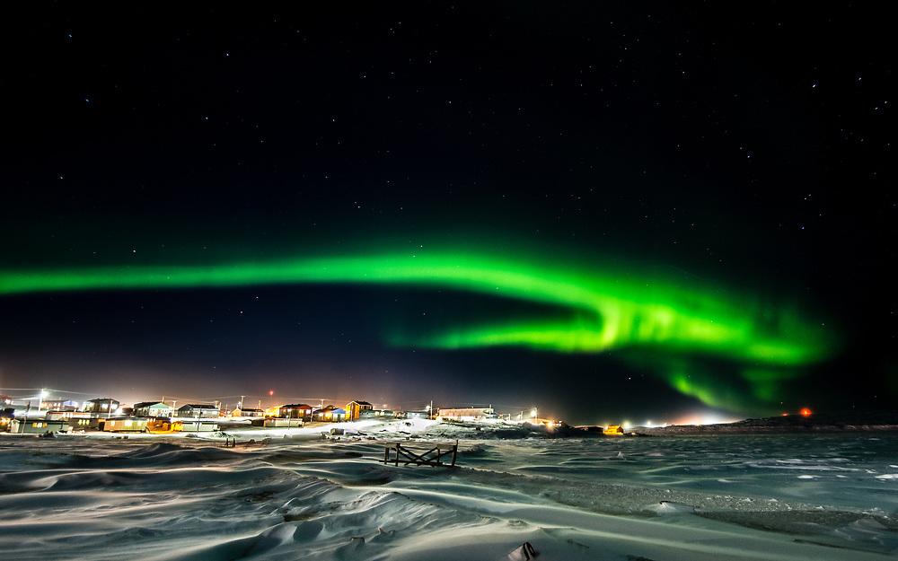 The northern light are so impredictible in their shapes. This one look like an animal jumping over Inukjuak.