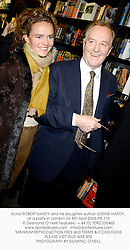 Actor ROBERT HARDY and his daughter author JUSTINE HARDY, at a party in London on 8th April 2003.	PIS 115