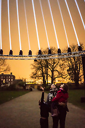 © Licensed to London News Pictures.  10/01/2019.LONDON UK. A family get a preview of Light and Sound installation The Nest, in Lloyd Park,Waltham Forest, Part of this weekends launch of Welcome to the Forest, the first event as part of Waltham Forest London Borough of Culture 2019 year.<br /> Photo credit: Andrew Baker/LNP