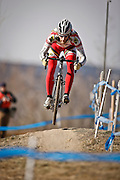 SHOT 1/12/14 1:55:16 PM - Joseph Maloney (#36) of Milwaukee, Wis. catches air off a small jump while warming up for the Men's Elite race at the 2014 USA Cycling Cyclo-Cross National Championships at Valmont Bike Park in Boulder, Co.  (Photo by Marc Piscotty / © 2013)