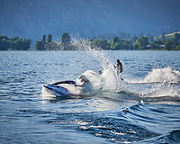3Jet Skiers crossing the ferry wake on Lake Chelan. Image taken with a Nikon D3x camera and 70-300 mm VR lens (ISO 400, 300 mm, f/10, 1/1000 sec).