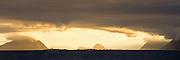 Golden morning light on west coast of Norway. High resolution panoramic picture   Gyllent morgenlys over Godøy, Grasøyene, Ålesund og Flø. Høyoppløslig panoramaformat.