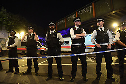 """Police officers man a cordon near the Seven Sisters Road at Finsbury Park in north London, where one person has been arrested after a vehicle struck pedestrians, leaving """"a number of casualties""""."""
