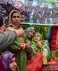 May 3, 2019 - Pulwama, Jammu and Kashmir, India - Mother (Right) of Lateef Tiger seen grieving during the funeral procession of her son in Dogripora village..Thousands of people attend the funeral procession of Lateef Ahmed Dar alias Lateef ''Tiger'' at his residence in Dogripora village, South of Srinagar. Lateef ''Tiger'', the last surviving militant of the 10 associates of Hizbul Mujhaideen commander Burhan Wani, who was killed in an encounter in July 2016. Lateef was among three Rebels killed in an encounter by Indian forces in poll-bound Shopian district of Jammu and Kashmir, the Army said. (Credit Image: © Idrees Abbas/SOPA Images via ZUMA Wire)