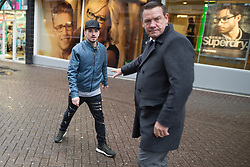 """© Licensed to London News Pictures . 28/01/2017 . Stoke-on-Trent , UK . Security guards push back a protester who calls Paul Nuttall a """"racist scouse twat"""" . UKIP formally launch their campaign in the by-election in the constituency of Stoke-on-Trent Central , at their new campaign shop at 1 Piccadilly in Stoke , with candidate - and party leader - Paul Nuttall . The seat was vacated when Tristram Hunt resigned . Photo credit : Joel Goodman/LNP"""
