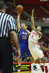 30 January 2011: Anthony Cousin challenges a shot by Ryan Wedel during an NCAA basketball game between the Drake Bulldogs and the Illinois State Redbirds. The Redbirds win in OT 77-75 after a last three point shot by Drake was ruled too late at Redbird Arena in Normal Illinois.