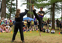 Hannah Fife-Huckins and Dylan Beckley from White Tiger Karate do a demonstration for the crowd gathered at Pines Park during Tilton-Northfield's Old Home Day on Saturday.  (Karen Bobotas/for the Laconia Daily Sun)