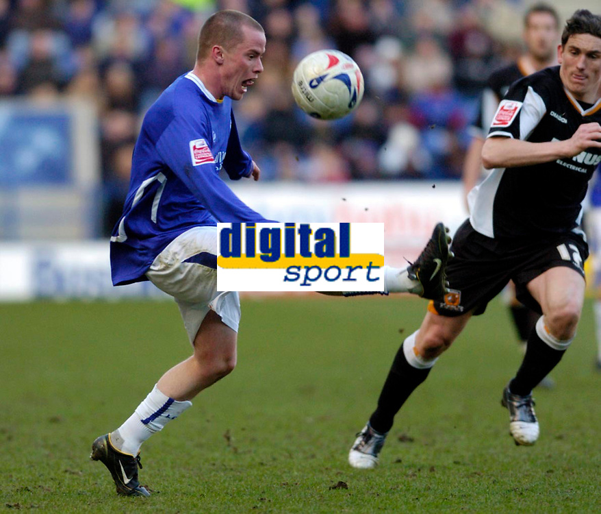 Photo: Leigh Quinnell.<br /> Leicester City v Hull FC. Coca Cola Championship. 04/03/2006. Leicester Iain Hume keeps the ball from Hulls Keith Andrews.