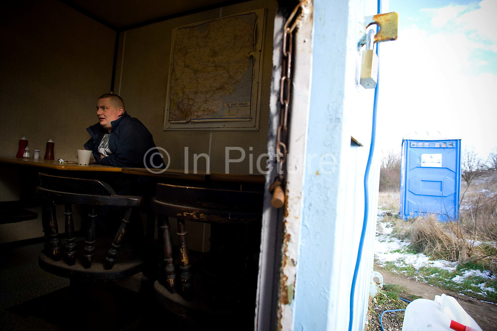 A male lorry driver stops for a cup of tea and lunch at the Pit Stop Cafe along the A12 on the 11th February 2010 near Kelvedon in the United Kingdom.