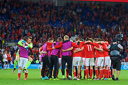 CARDIFF, WALES - Saturday, September 2, 2017: Wales' players form a post-match huddle after the final whistle as they celebrate a 1-0 victory in the 2018 FIFA World Cup Qualifying Group D match between Wales and Austria at the Cardiff City Stadium. (Pic by Paul Greenwood/Propaganda)