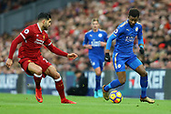 Demarai Gray of Leicester City (r) looks to go past Emre Can of Liverpool. Premier League match, Liverpool v Leicester City at the Anfield stadium in Liverpool, Merseyside on Saturday 30th December 2017.<br /> pic by Chris Stading, Andrew Orchard sports photography.