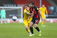 Football - 2020 / 2021 Sky Bet Championship - AFC Bournemouth vs. Barnsley - The Vitality Stadium<br /> <br /> Dominik Frieser of Barnsley gets to grips with Bournemouth's Ben Pearson during the Championship match at the Vitality Stadium (Dean Court) Bournemouth <br /> <br /> COLORSPORT/SHAUN BOGGUST