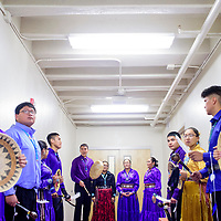 The Miyamura High School Navajo language and culture club gathers outside the gymnasium as they prepare to perform at the Gallup McKinley County Schools Navajo Language and Culture Day at Miyamura High School Tuesday.