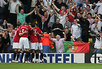 Photo: Lee Earle.<br /> Watford v Manchester United. The Barclays Premiership. 26/08/2006. United's Ryan Giggs is congratulated after scoring their second.