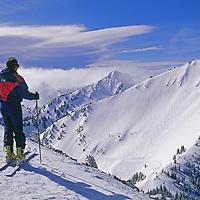 A skier overlooks Powder Bowl at Crystal Mountain, Washington.