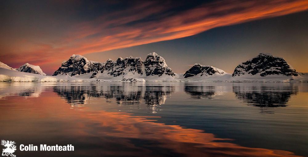 Wiencke Island peaks, Fief Range, sunset reflection, near Port Lockroy, Antarctic Peninsula