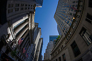 Distorted fish-eye lens view of the New York Stock Exchange (NYSE) on Wall Street, Lower Manhattan. The extreme nature of this specialist lens bends straight lines and translates them into curves to show this famous street symbolises the US economy. Wall Street is a 0.7 miles (1.1 km), eight-block-long, street running west to east from Broadway to South Street on the East River in Lower Manhattan in the financial district of New York City. Over time, the term has become a metonym for the financial markets of the United States as a whole, the American financial sector or signifying New York-based financial interests. The NYSE is world's largest stock exchange by market capitalization of its listed companies at US$16.613 trillion as of May 2013. Average daily trading value was approximately US$169 billion in 2013.
