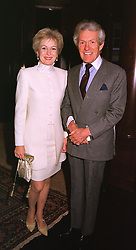 LADY ANNUNCIATA ASQUITH and the EARL OF LICHFIELD at a party in London on 5th May 1999.MRR 65