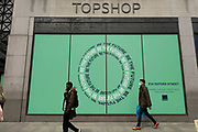 People out and about pass the now closed Topshop store on Oxford Street on 25th May 2021 in London, United Kingdom. As the coronavirus lockdown continues its process of easing restrictions, more and more people are coming to the West End as more businesses open.