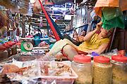 26 JUNE 2006 - SIEM REAP, CAMBODIA: A vendor in the main market in Siem Reap, Cambodia, site of the world famous Angkor Wat. Photo by Jack Kurtz / ZUMA Press