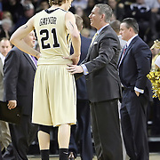 Central Florida forward P.J. Gaynor (21) and Head Coach Donnie Jones talk during a Conference USA NCAA basketball game between the Rice Owls and the Central Florida Knights at the UCF Arena on January 22, 2011 in Orlando, Florida. Rice won the game 57-50 and extended the Knights losing streak to 4 games.  (AP Photo/Alex Menendez)