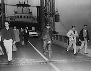 The Vashon-Southworth ferry bumped gently into the Fauntleroy slip on schedule at 7:25 o'clock despite the fog. The gates went up. Out of the mass of hurrying pedestrians burst a bearded bicyclist, pedaling like mad. (The Seattle Times, 1961)