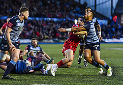 Scarlets' Gareth Davies is tackled by Cardiff Blues' Willis Halaholo - Mandatory by-line: Craig Thomas/Replay images - 31/12/2017 - RUGBY - Cardiff Arms Park - Cardiff , Wales - Blues v Scarlets - Guinness Pro 14