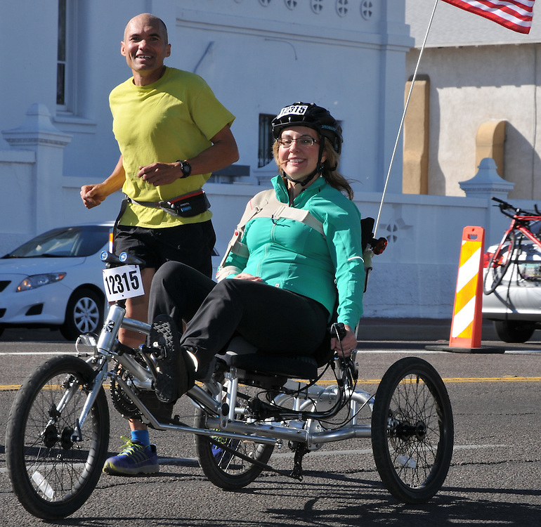 Former Congresswoman Gabrielle Giffords rounds the corner of 22nd Street and 6th Avenue during the 2016 Tour de Tucson fun ride. Bike-tography by Martha Retallick.