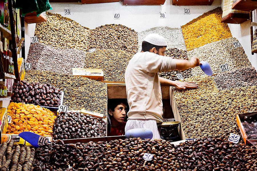 Nut and dried fruit vendors keep tidy in their stall at a market in the Marrakech medina, Morocco on November 16, 2007.