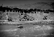Russian military vehicles from Afghanistan's last war litter bed of a river vital for drinking water and for irrigation on the road to the Salang Pass, Charikar, Afghanistan.
