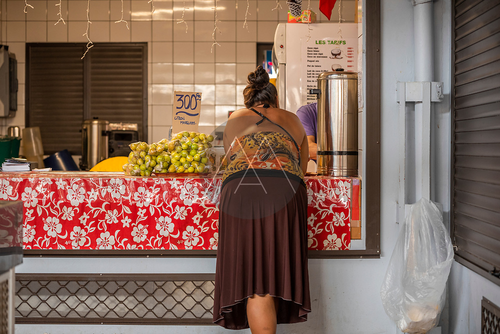 Tahiti, French Polynesia - 25 February 2019: People in the local market in Tahiti island during summertime, French Polynesia.