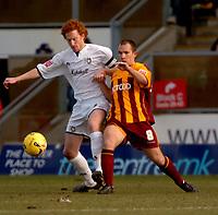 Photo: Ian Hebden.<br /> <br /> Milton Keynes v Bradford City. Coca Cola League 1. 25/02/2006.<br /> <br /> MK Dons Dean Lewington (L) is challenged by Bradfords Marc Bridge-Wilkinson (R).