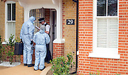 © Licensed to London News Pictures. 23/04/2014. New Malden, UK. Forensics officers arrive at the house.  The scene in New Malden where a woman has been arrested after the discovery of three bodies of children in a house overnight. Photo credit : Stephen Simpson/LNP