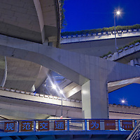 Asia, China, Shanghai, Night view of concrete highway overpasses rising above Yan'an Elevated Freeway on summer evening.