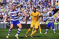 Reading defender Paul McShane (5) in defence against Preston North End forward Jermaine Beckford (10) during the EFL Sky Bet Championship match between Reading and Preston North End at the Madejski Stadium, Reading, England on 6 August 2016. Photo by Jon Bromley.