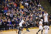 Golden State Warriors guard Stephen Curry (30) falls to the floor after being fouled by Brooklyn Nets guard Spencer Dinwiddie (8) during a buzzer beating three pointer in the second quarter at Oracle Arena in Oakland, Calif., on February 25, 2017. (Stan Olszewski/Special to S.F. Examiner)