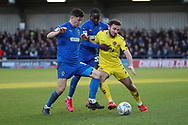 AFC Wimbledon midfielder Callum Reilly (33) and AFC Wimbledon defender Paul Osew (37) battles for possession with Fleetwood Town defender Lewis Coyle (2) during the EFL Sky Bet League 1 match between AFC Wimbledon and Fleetwood Town at the Cherry Red Records Stadium, Kingston, England on 8 February 2020.