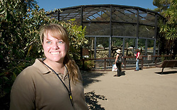 Margaret Rousser, lead keeper at the Oakland Zoo, poses for a photograph outside the chimpanzee enclosure, Tuesday, Aug. 24, 2010 in Oakland, Calif. The zoo recently acquired two new male chimps, and now has seven of the primates, three males and four females. (D. Ross Cameron/Staff)