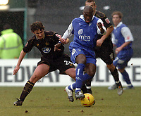 Picture: Henry Browne.<br /> Date: 26/02/2005.<br /> Gillingham v Wigan Athletic Coca Cola Championship.<br /> Nyron Nosworthy of Gills is hounded by Gareth Whalley of Wigan.