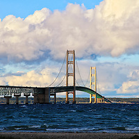 """""""Mackinac Bridge""""-1<br /> <br /> A wonderful view of the beautiful Mackinac Bridge as viewed from Mackinaw City. Mackinac Bridge along with lovely puffy clouds and deep blue waters, combine to make a fantastic image!!<br /> <br /> Mackinac Bridge by Rachel Cohen"""