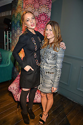 Left to right, LINDSAY LOHAN and JULIET ANGUS at the Duresta For Matthew Williamson Exclusive Launch At Harrods, Knightsbridge, London on 10th March 2016.