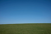 Crest of a hill covered in green grass against a pure blue sky on 4th April 2021 in Studley, United Kingdom. (photo by Mike Kemp/In Pictures via Getty Images)
