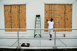 September 5, 2017 - Lake Worth, Florida, U.S. - In preparation for Hurricane Irma, PEDRO GABRIEL installs window protection at Bulldoggers Antiques in Lake Worth Tuesday. (Credit Image: © Bruce R. Bennett/The Palm Beach Post via ZUMA Wire)