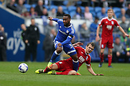 Junior Hoilett of Cardiff city (l) is fouled by Robert Tesche of Birmingham city.   EFL Skybet championship match, Cardiff city v Birmingham City at the Cardiff City Stadium in Cardiff, South Wales on Saturday 11th March 2017.<br /> pic by Andrew Orchard, Andrew Orchard sports photography.