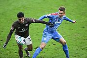 Fussball: 2. Bundesliga, FC St. Pauli - Holstein Kiel, Hamburg, 09.01.2021<br /> Omar Marmoush (Pauli, l.) - Hauke Wahl (Kiel)<br /> © Torsten Helmke